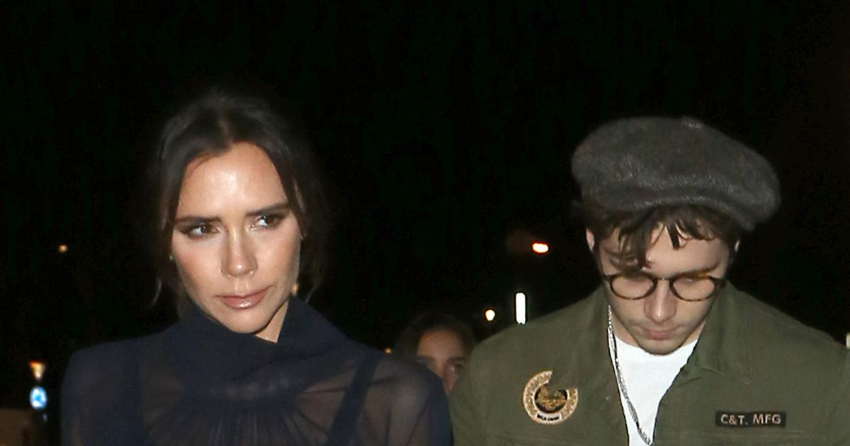 Victoria Beckham flashes bra on night out with husband David and son Brooklyn