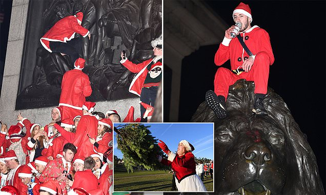 Hundreds of revellers dressed as Father Christmas dance the night away