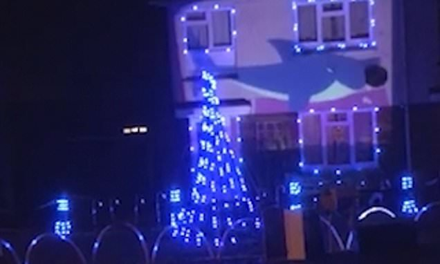 Family decorates their house in Baby Shark Christmas lights
