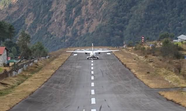 Plane leaves Everest camp on runway that falls away to 2,000ft DROP