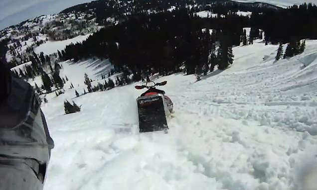 Snowmobile rider falls off and watches as it carries on and hits trees