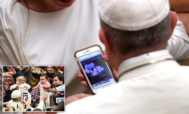 Pope blesses pregnant mother's ULTRASOUND as she shows scan on phone
