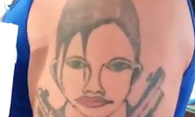 Tat's it? Man unveils shocking new Angelina Jolie tattoo