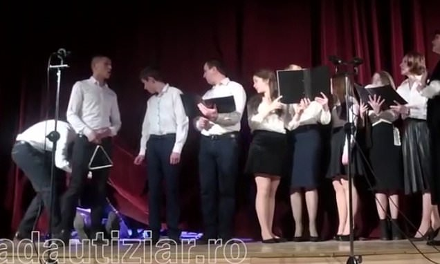 Chorister faints on stage and singers cover him with a curtain