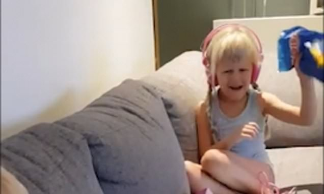 Siblings, three and five, are given bag of BROCCOLI for Christmas