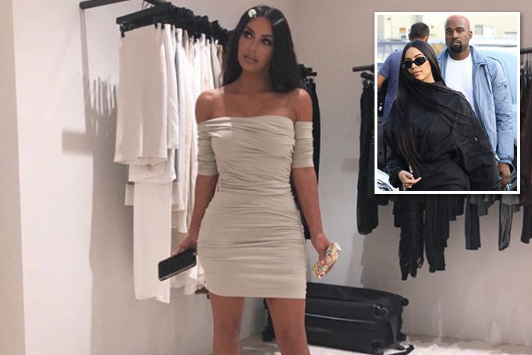 Kim Kardashian stuns in skintight bardot dress after admitting husband Kanye 'dressed me up as a doll'
