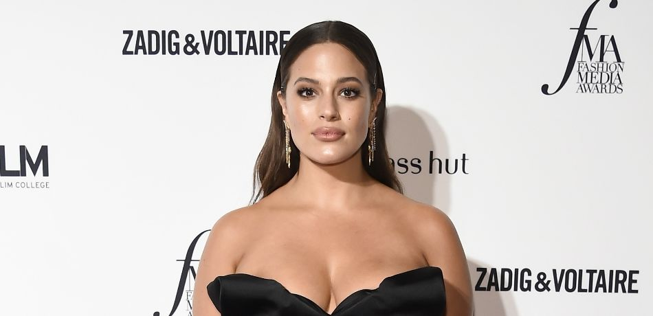 Ashley Graham Flaunts Serious Curves In A Bright Purple Bikini In New Video