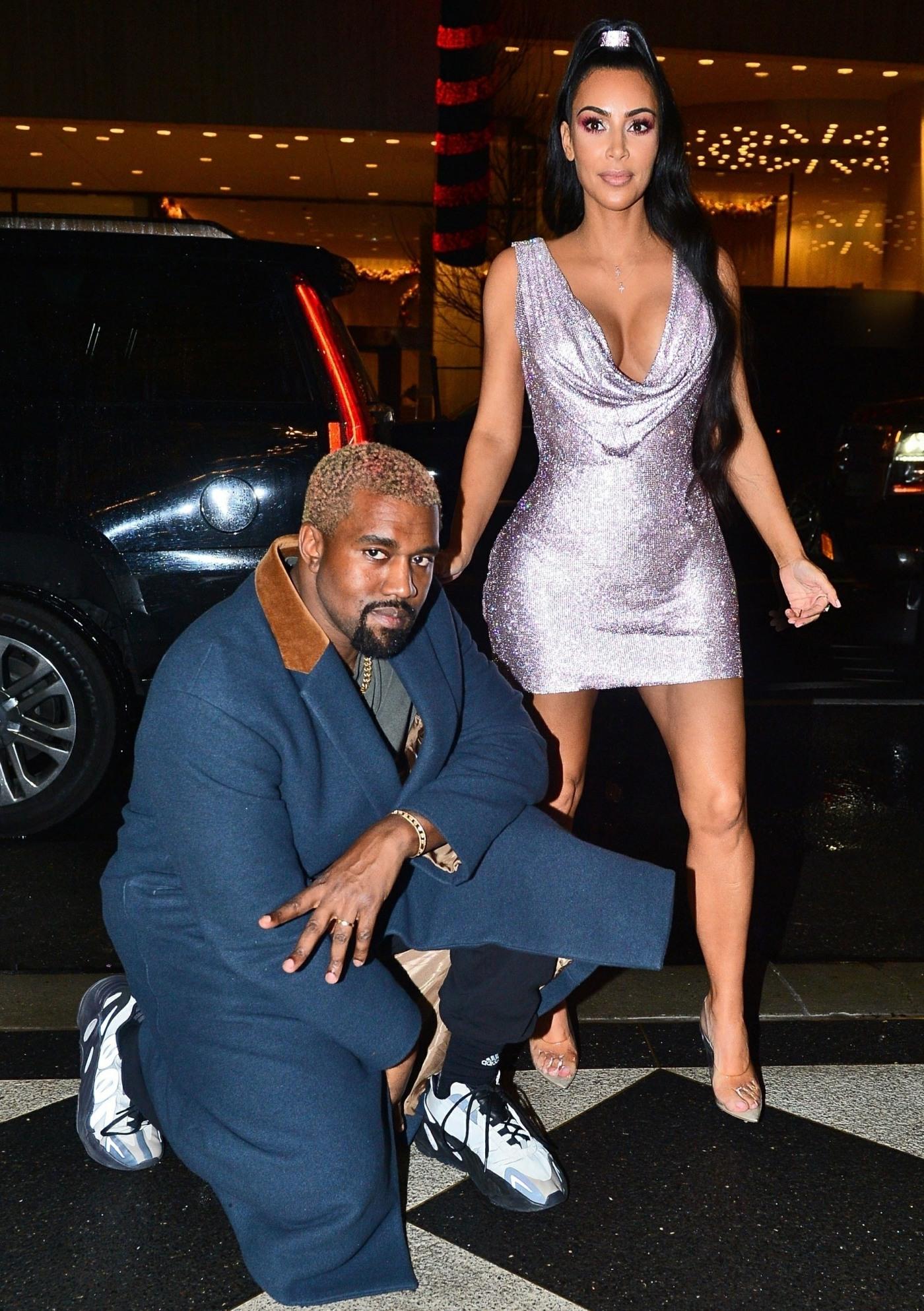 Kim Kardashian & Diane Kruger brought their men to the NYC Versace show