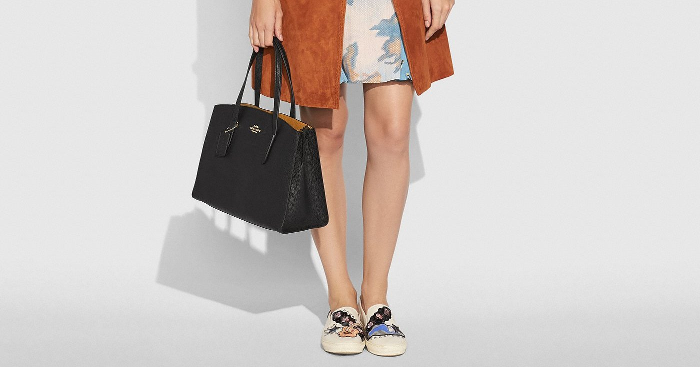 The Coach Charlie Carryall Has a Customizable Twist You'll Love
