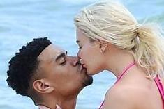Megan Barton Hanson snogs Wes Nelson after he rubs lotion into her bum on the beach in Mauritius