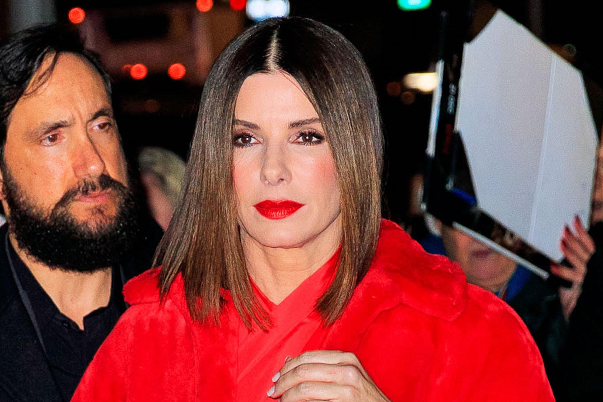 Sandra Bullock stuns in red-hot look worth $6K