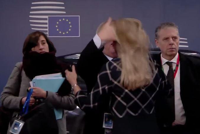 Bizarre footage shows the man holding UK hostage ruffle woman's hair as he arrives for crunch Brussels talks