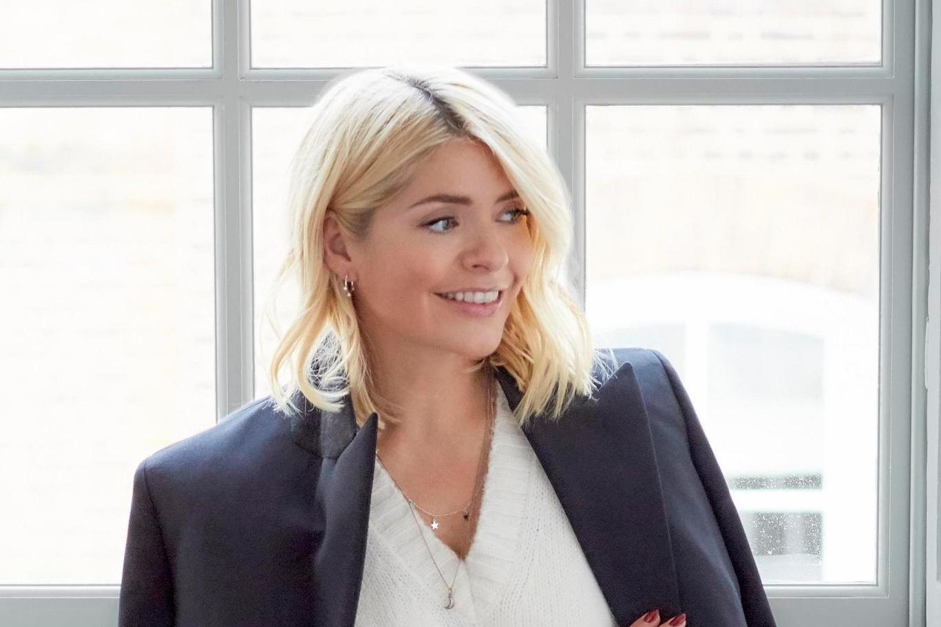 Holly Willoughby reveals she loves her curvy figure and is 'much happier' with her face now she's older