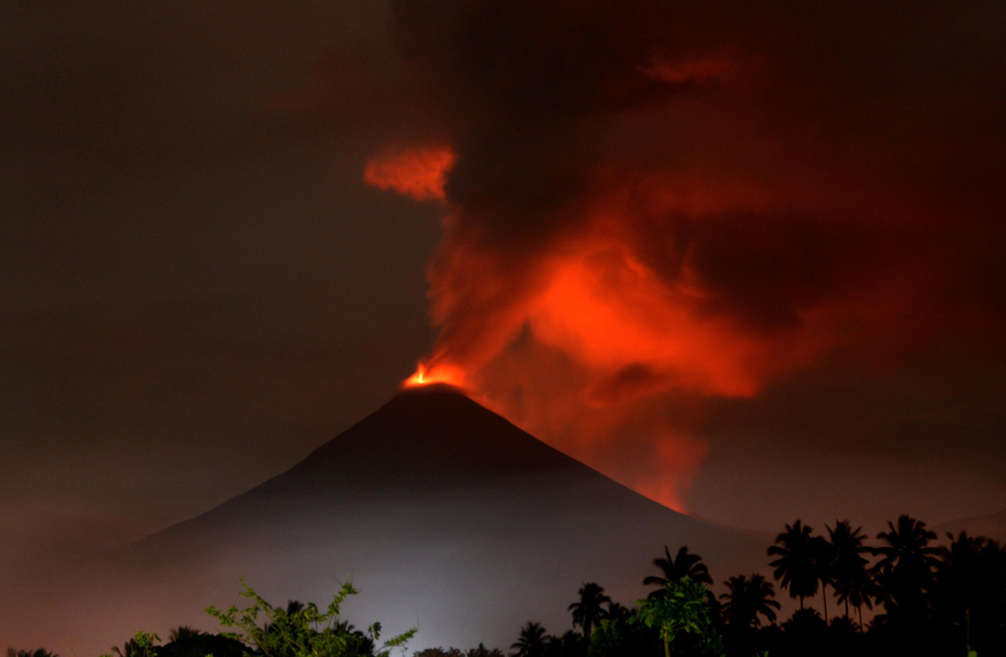 Indonesian volcano Mount Soputan erupts sending thick ash into the sky