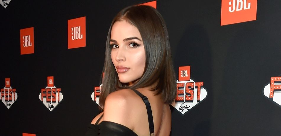 'Sports Illustrated' Swimsuit Model Olivia Culpo Goes Goth, Busts Out Of Tight & Strappy See-Through Dress
