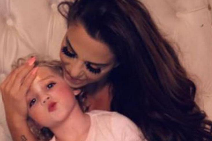 Katie Price cuddles daughter Bunny as she prepares for blow-out family Christmas after swerving bankruptcy twice