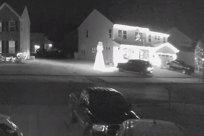 'Grinch' caught on video driving through home's Christmas display