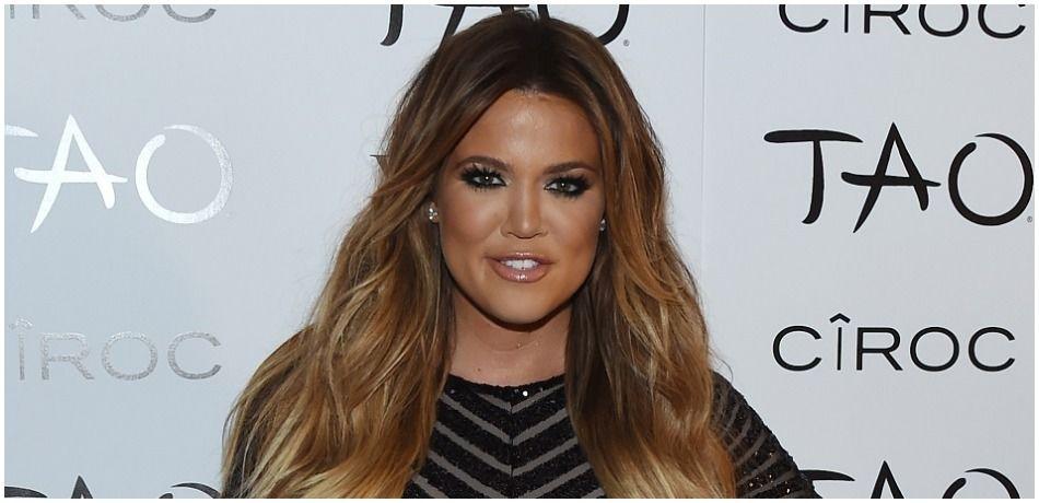 Khloe Kardashian Busts Out Of Skimpy Sports Bra In Sexy New Photo