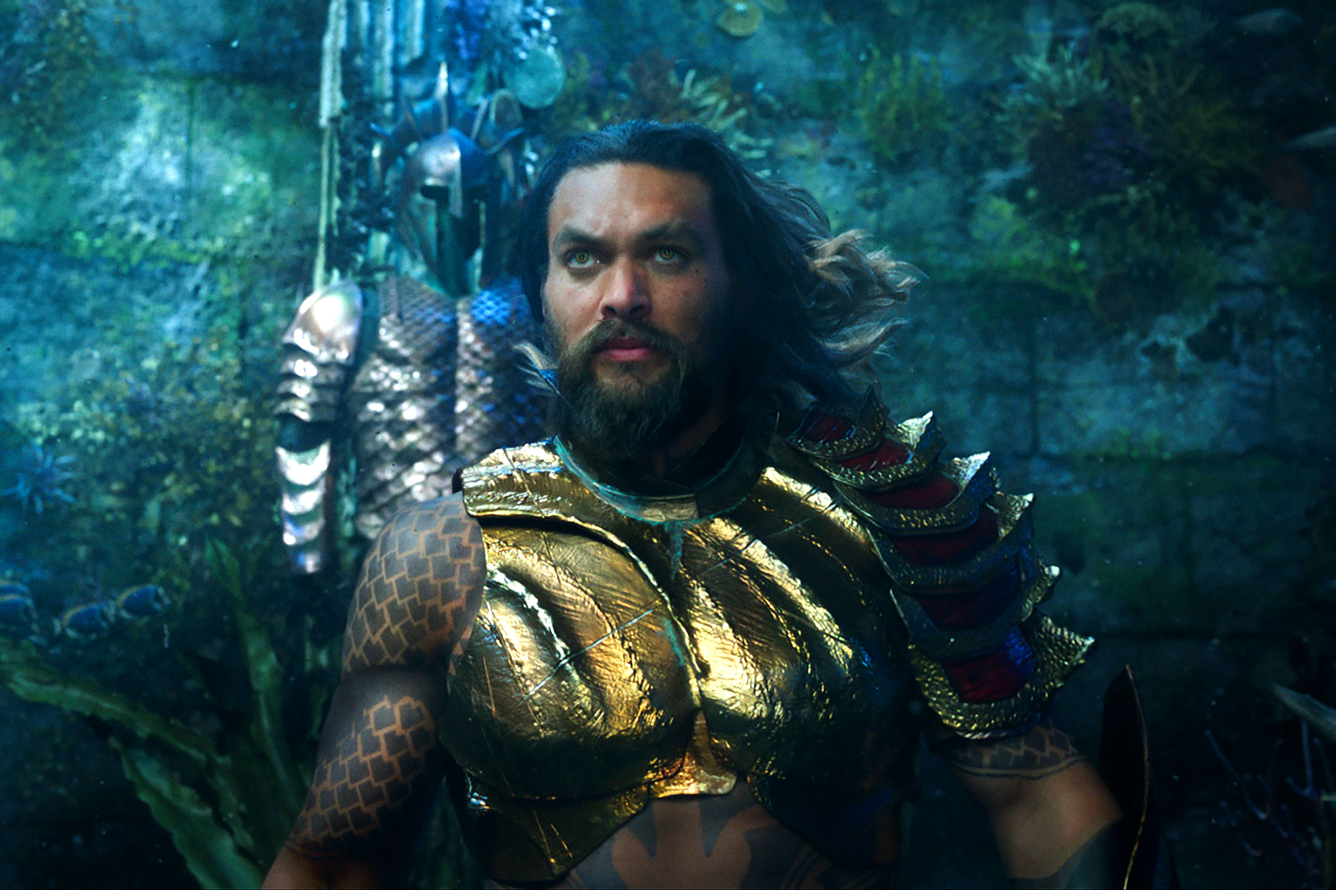 Aquaman EW review: Jason Momoa, Amber Heard film can't decide if it wants to be silly or serious