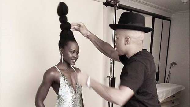 Lupita Nyong'o's Hairstylist Learned to Braid on a Mop