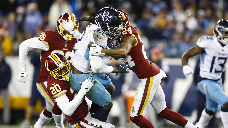 Redskins' Josh Norman throws helmet at Titans' Taylor Lewan in postgame clash