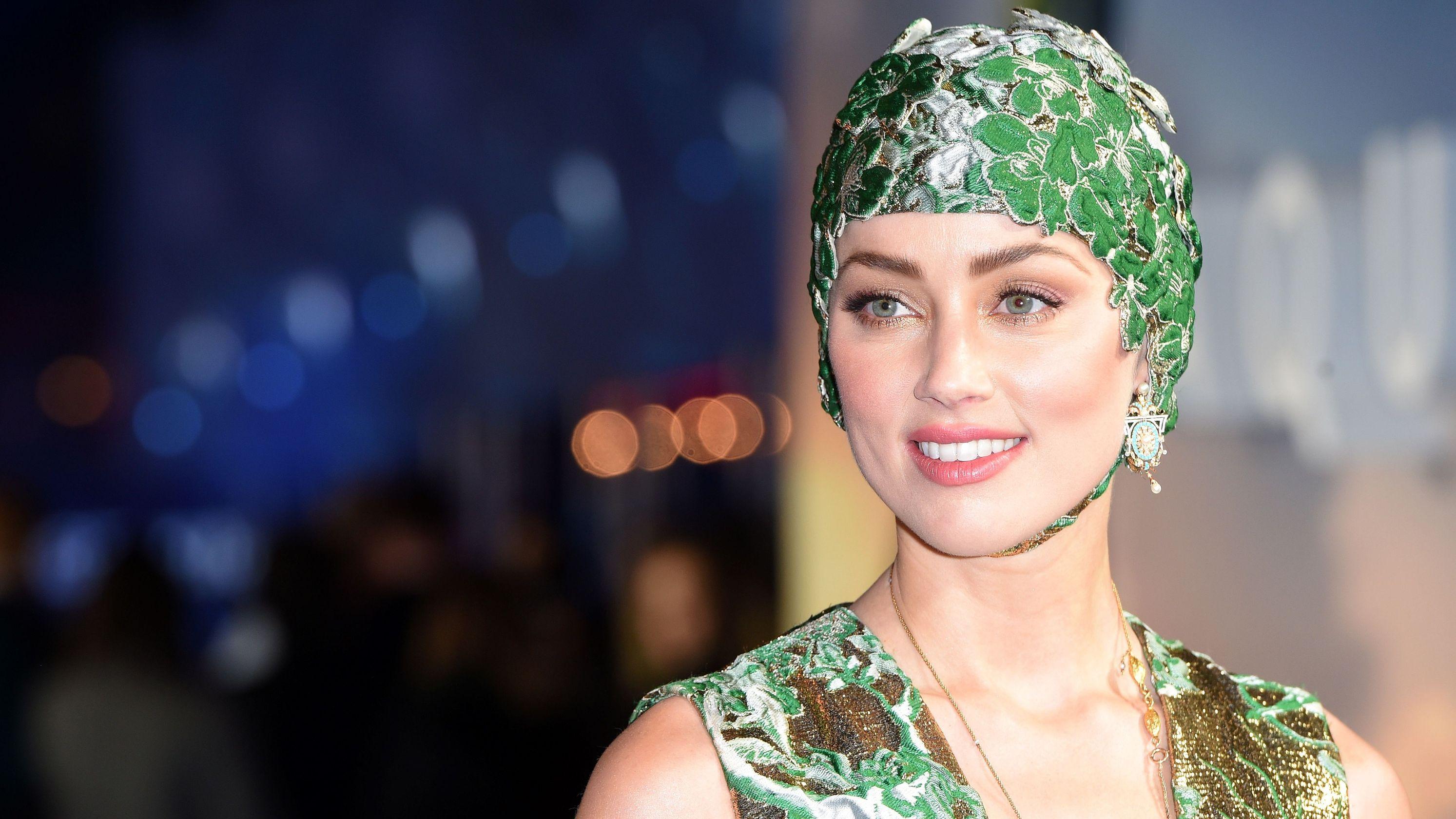 'Aquaman' star Amber Heard laments saying goodbye to her Valentino swim cap