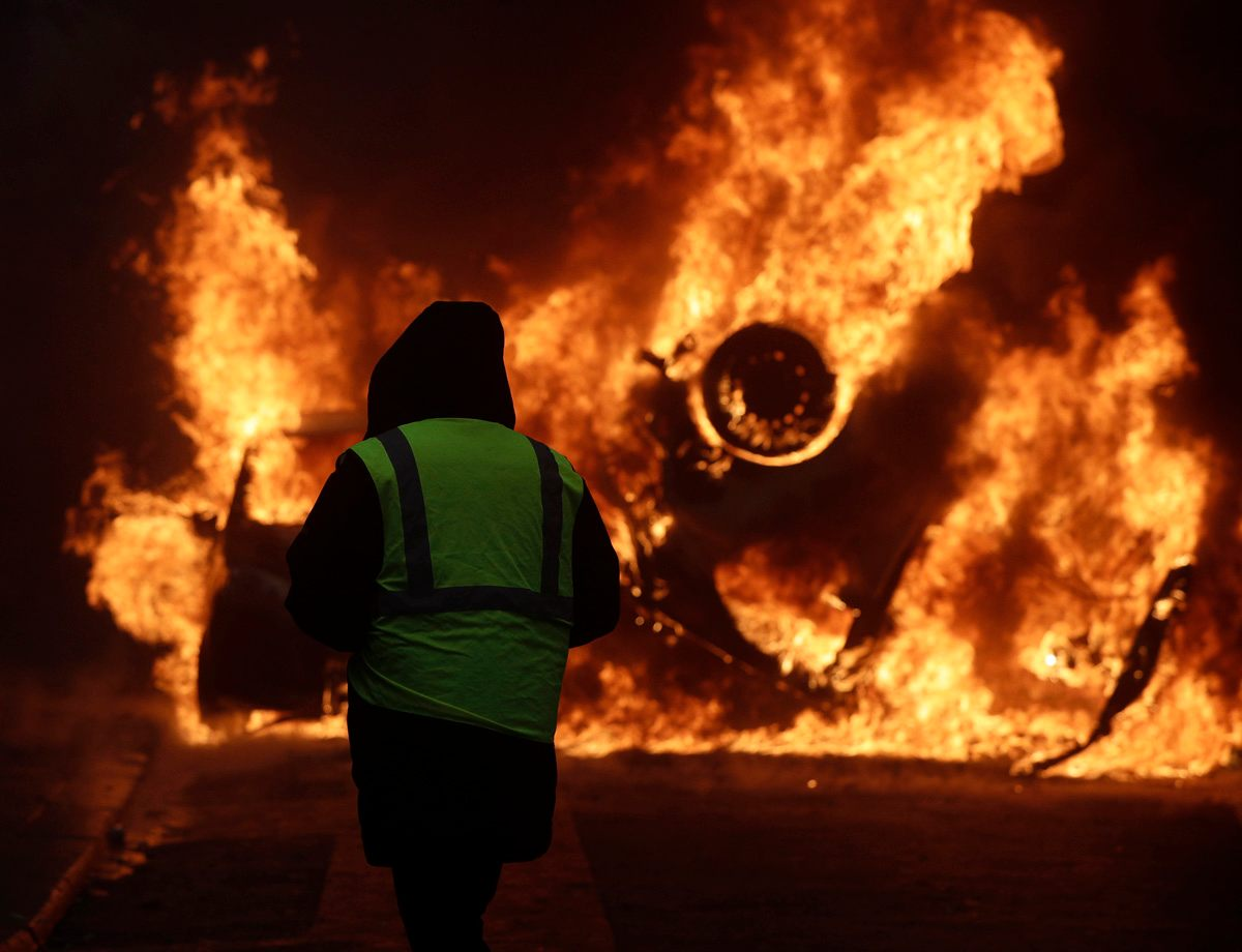 France's Macron scraps fuel tax rise amid fears of more protests, violence