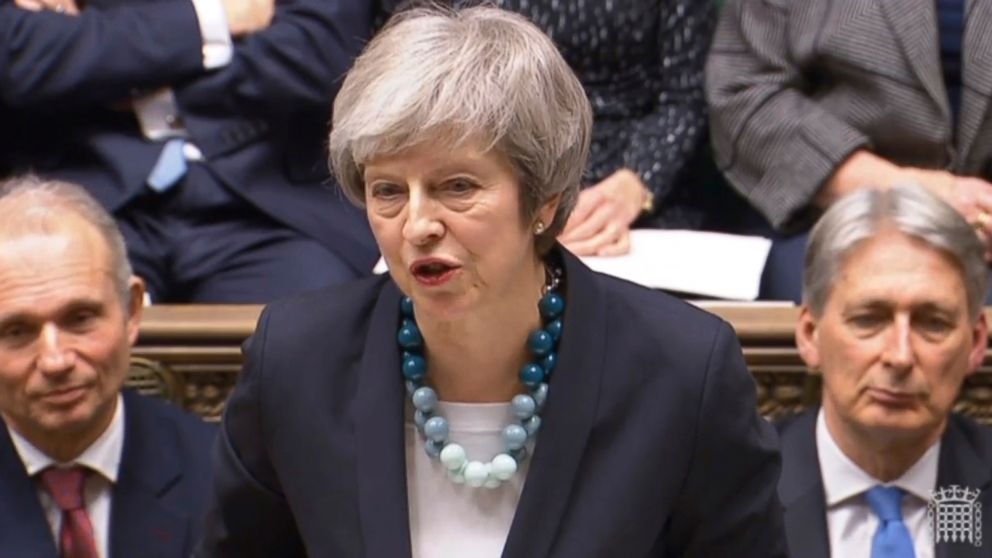 Theresa May says she will delay a planned vote on Brexit despite furious Parliament