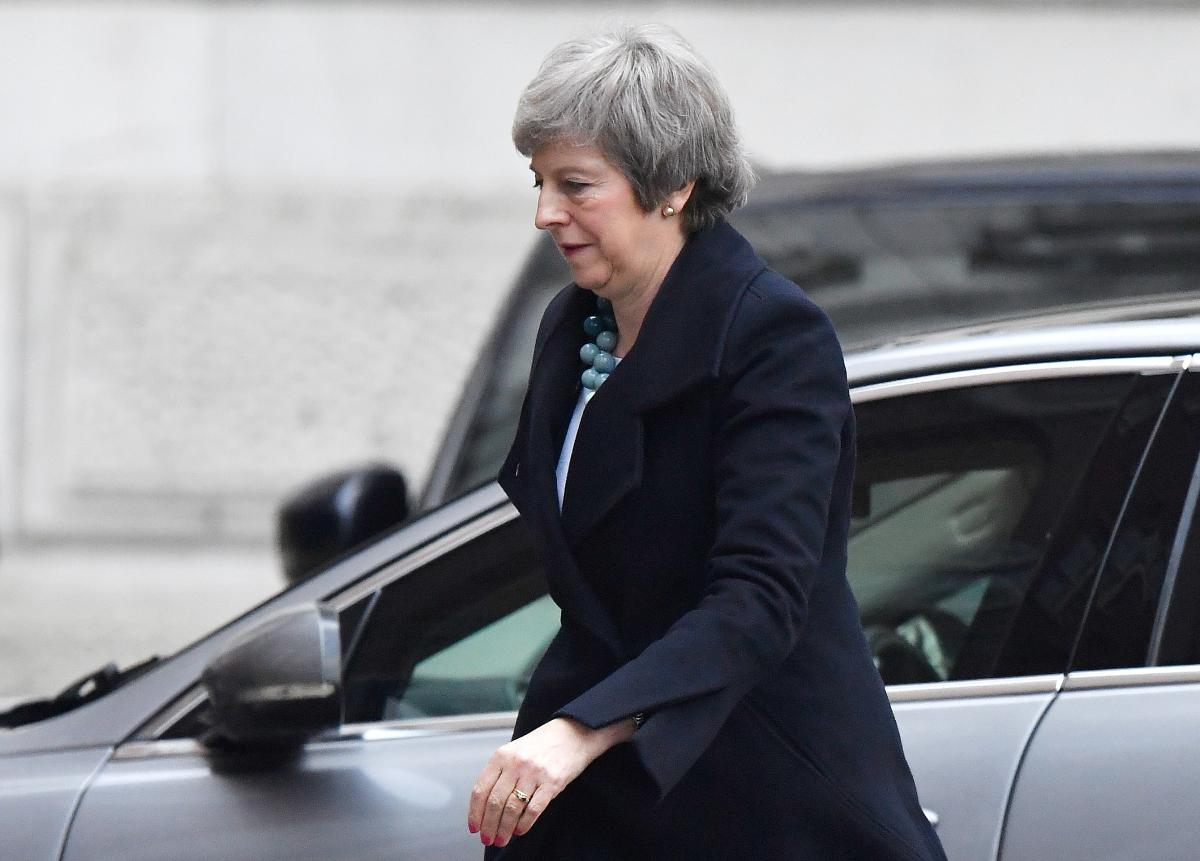 Britain's May to meet Germany's Merkel after delaying Brexit vote
