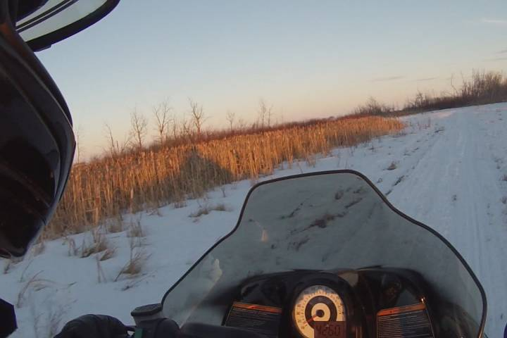 Snowmobilers of Manitoba waiting on more snow before opening trails