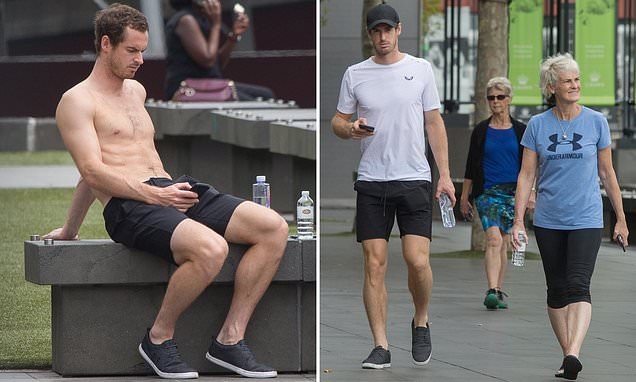 Andy Murray goes shirtless as he relaxes in the sun with mother Judy