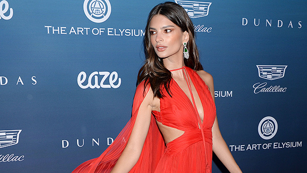 Emily Ratajkowski Narrowly Avoids Wardrobe Malfunction Going Braless In Unbuttoned Dress – Pic
