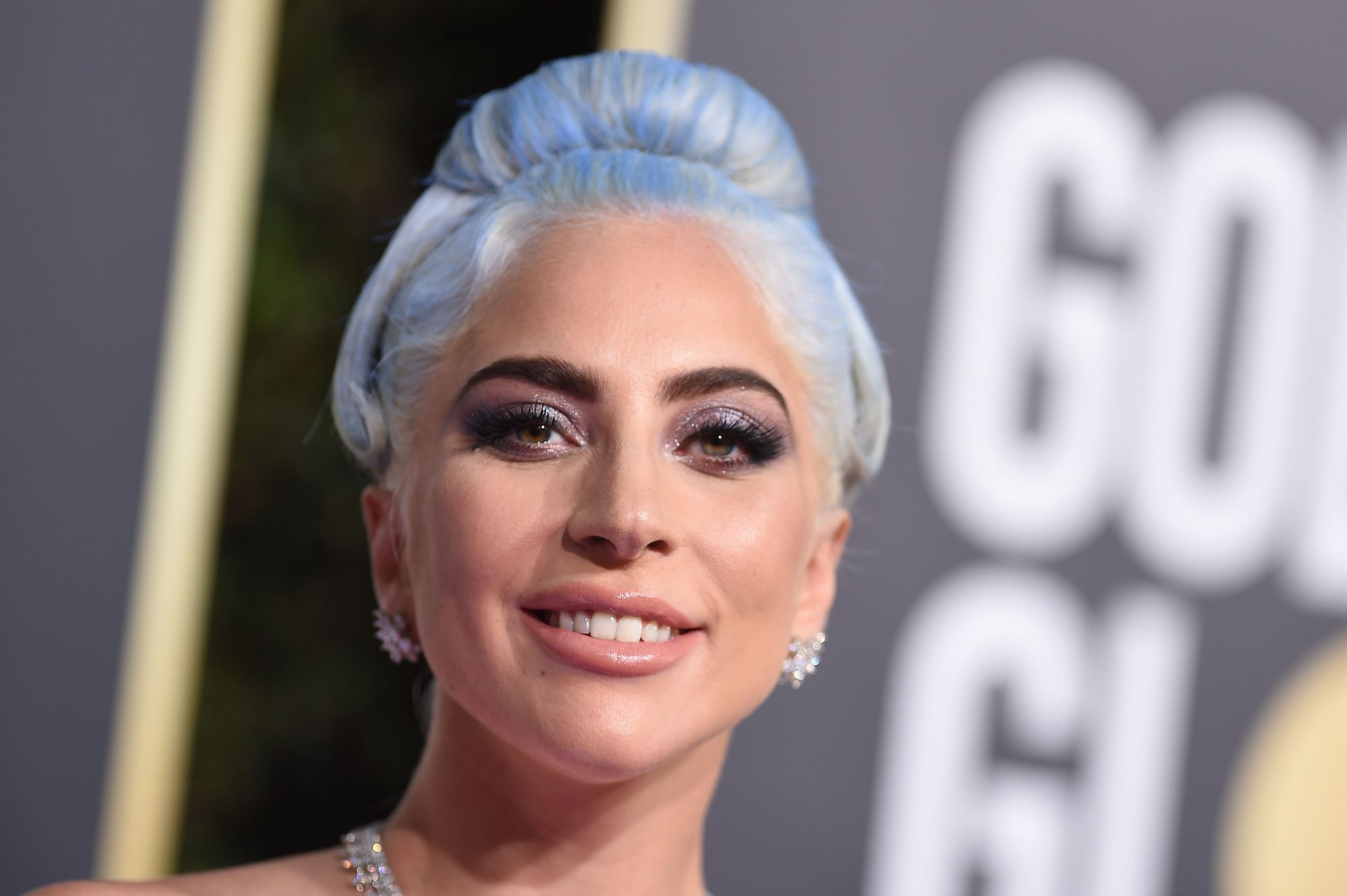 Lady Gaga wears over 100 carats of diamonds to the Golden Globes