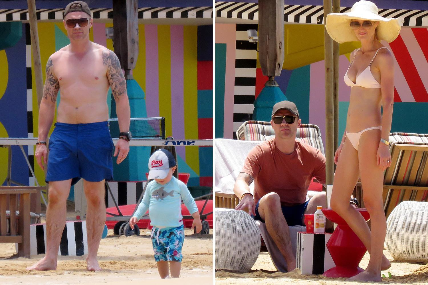 Ronan Keating goes shirtless as he and wife Storm play with their kids on the beach in Mauritius