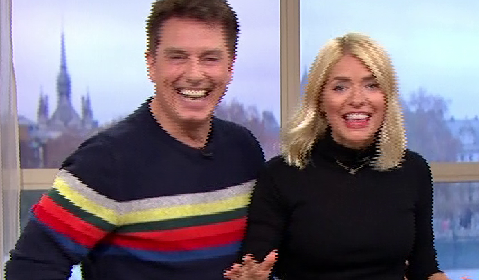 Holly Willoughby screams in terror as John Barrowman chucks SPIDERS at her as he replaces Phillip Schofield on This Morning