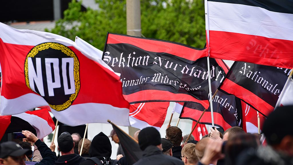 German far-right party threatens to start street patrols after ethnic violence