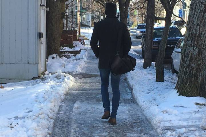 Rain and freeze makes for a slippery commute for pedestrians in Halifax