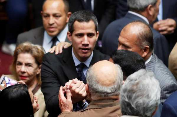 Venezuela power struggle heats up with Guaido curbs, protest plans