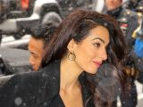 Amal Clooney wows in red jumpsuit as she arrives for Meghan Markle's baby shower