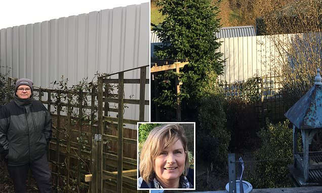 Row as neighbour installs 14ft metal fence in Welsh village