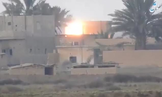 ISIS fighters fire anti-tank missiles at Syrian forces