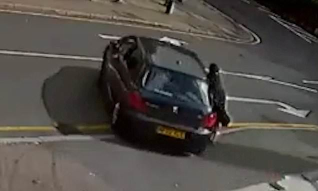 Shocking moment fuel thief drags petrol station worker across the road