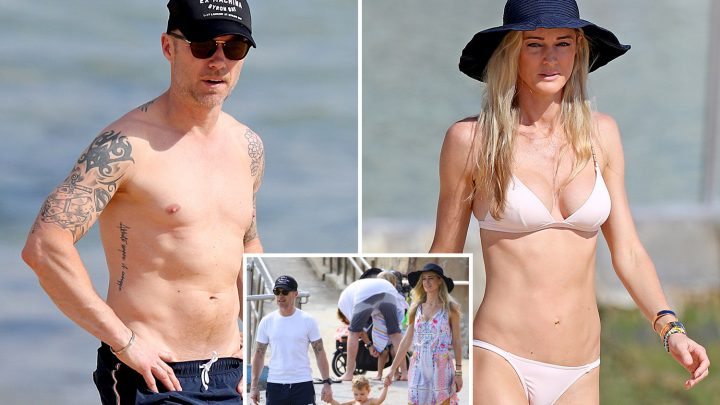 Ronan Keating goes topless and shows off tattoos in rare beach outing with wife Storm