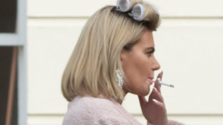 Megan Barton-Hanson smokes with her hair in rollers on a break from photo shoot