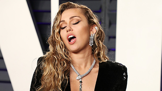 Miley Cyrus Drenches Herself In 'Drake's Tears' & Throws Holy Water At Her 'Haters' In New Bikini Pics
