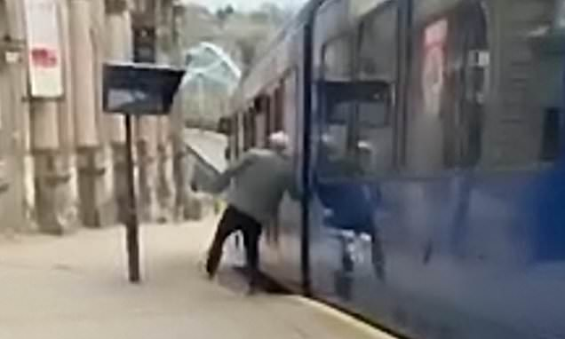 Shocking moment a 'drunk' man falls on to tracks as a tram pulls away