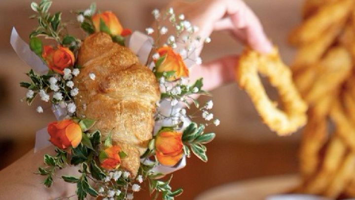 Croissant Corsages Exist & The Photos Are Truly Delicious