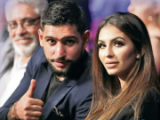 What is Amir Khan's net worth, who is his wife Faryal Makhdoom and how many children do they have?