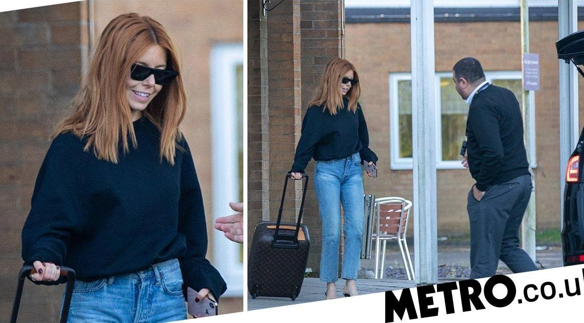 Stacey Dooley all smiles leaving hotel after 'spending night with Kevin Clifton'