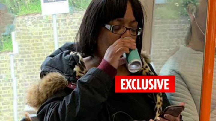 Labour's Diane Abbott breaks the law by swigging can of mojito on the train home